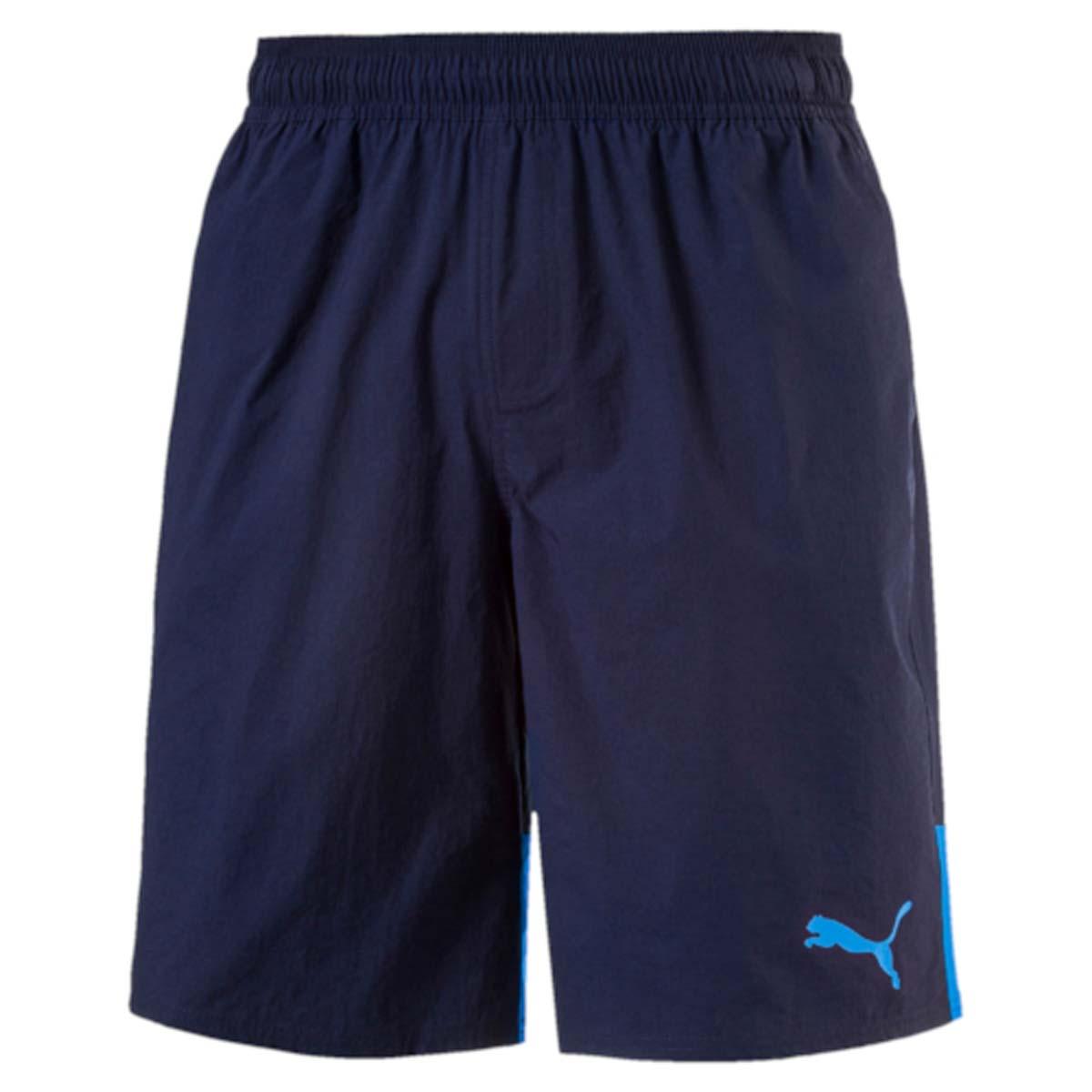 Шорты мужские Puma Style Summer Stretch Shorts, цвет: синий. 59066506. Размер XL (52/54)59066506Мужские шорты Style Summer Stretch Shorts созданы для тех, кто ценит комфорт и свободу движений. Эластичная ткань прекрасно тянется и не стесняет движений. В таких шортах удобно тренироваться, гулять или просто заниматься повседневными делами. Эластичный пояс с затягивающимся шнурком гарантирует комфортную посадку. Боковые швы с нахлестом вперед способствуют свободе движений. Модель имеет боковые карманы. Также имеется внутренний карман для мелочи и прорезной карман с обтачками сзади. Шорты декорированы логотипом PUMA на левой штанине. Имеют стандартную посадку.