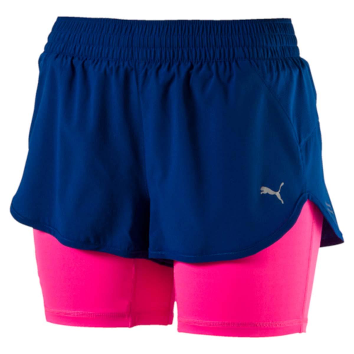 Шорты для бега женские Puma Blast 2in1 3 Short W, цвет: синий, розовый. 51507402. Размер XS (40/42)51507402Эти оригинальные тренировочные шорты 2 в 1 изготовлены с использованием высокофункциональной технологии dryCELL, которая отводит влагу, поддерживает тело сухим и гарантирует комфорт во время активных тренировок и занятий спортом. Внешние шорты из эластичной, хорошо растягивающейся ткани обеспечивают полную свободу движений, в то время как внутренние шорты выполнены из компрессионного, поддерживающего мышцы материала. Также шорты имеют вставки из сетчатого материала во избежание перегрева и декорированы логотипом и другими деталями из светоотражающего материала для обеспечения вашей безопасности в темное время суток. Ткань изделия обработана уникальной органической пропиткой Cleansport NXT, гарантирующей только приятные запахи. Карман сзади снабжен застежкой-молнией и водонепроницаемой подкладкой для надежного хранения ваших вещей. Кроме того, имеется вместительный боковой карман изменяемого объема для мобильного телефона. Пояс из эластичного материала с кулиской снабжен затягивающимся шнуром для лучшей посадки по фигуре.