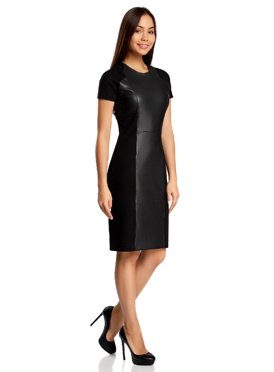 Платье oodji Collection, цвет: черный. 24007023/43060/2900N. Размер S (44-170)24007023/43060/2900NСтильное платье oodji Collection, выполненное из качественного комбинированного материала, отлично дополнит ваш гардероб. В качестве материала подкладки используется полиэстер. Модель-миди с круглым вырезом горловины и короткими цельнокроеными рукавами оформлена вставками из искусственной кожи. Платье застегивается сзади по спинке на застежку-молнию и дополнено небольшой шлицей.