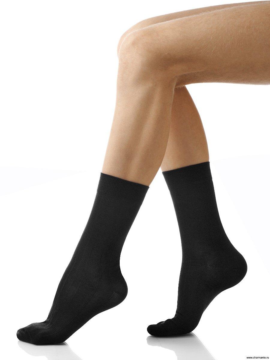 Носки мужские Charmante, цвет: черный. SCHM-1004. Размер 27-29 (42/44)SCHM-1004Мужские носки Charmante с удлиненным паголенком изготовлены из высококачественного материалаобеспечивающего великолепную посадку. Удобная широкая резинка идеально облегает ногу и не пережимает сосуды, усиленные пятка и мысок повышают износоустойчивость носка.