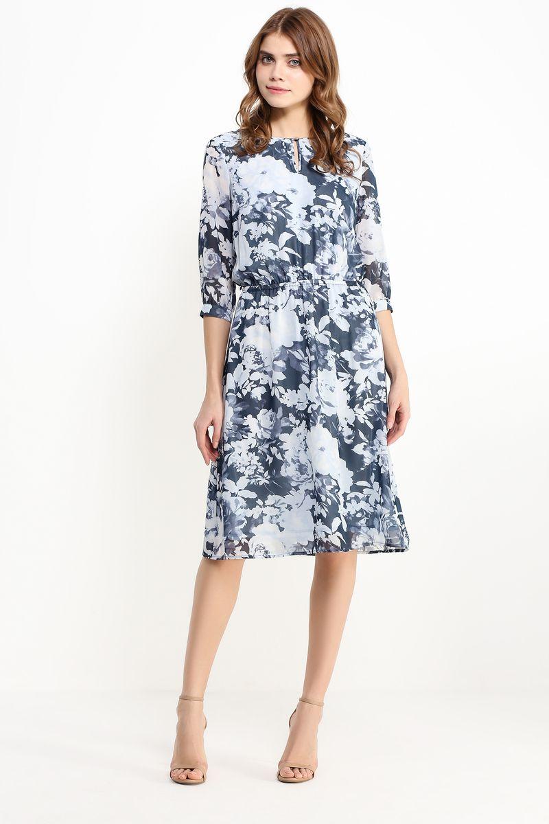 Платье Finn Flare, цвет: темно-синий, светло-серый. B17-11042. Размер S (44)B17-11042Стильное платье Finn Flare изготовлено из тонкого полиэстера. Модель застегивается сзади на пуговицу. Платье оформлено рисунком с крупными цветами. Талия собрана на вшитую внутреннюю резинку. Рукава дополнены манжетами, которые застегиваются на пуговицы. У модели имеется подкладка и тонкий пояс из искусственной кожи с металлической пряжкой.