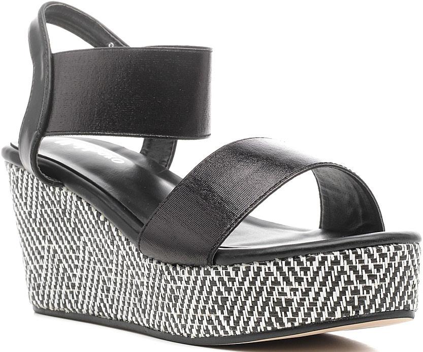 Босоножки женские Nobbaro, цвет: черный. 1152-130. Размер 371152-130Стильные босоножки от Nobbaroзаймут достойное место среди вашей коллекции летней обуви. Модель выполнена из искусственной кожи. Открытый носок и задник обеспечивают дополнительную вентиляцию, позволяют ногам дышать. Ремешок - резинка на щиколотке отвечает за надежную фиксацию модели на ноге. Стелька из искусственной кожи гарантирует комфорт при ходьбе. Высокая танкетка украшена стильным узором. Рифленая поверхность подошвы защищает босоножки от скольжения. Модные босоножки помогут вам создать яркий, запоминающийся образ.