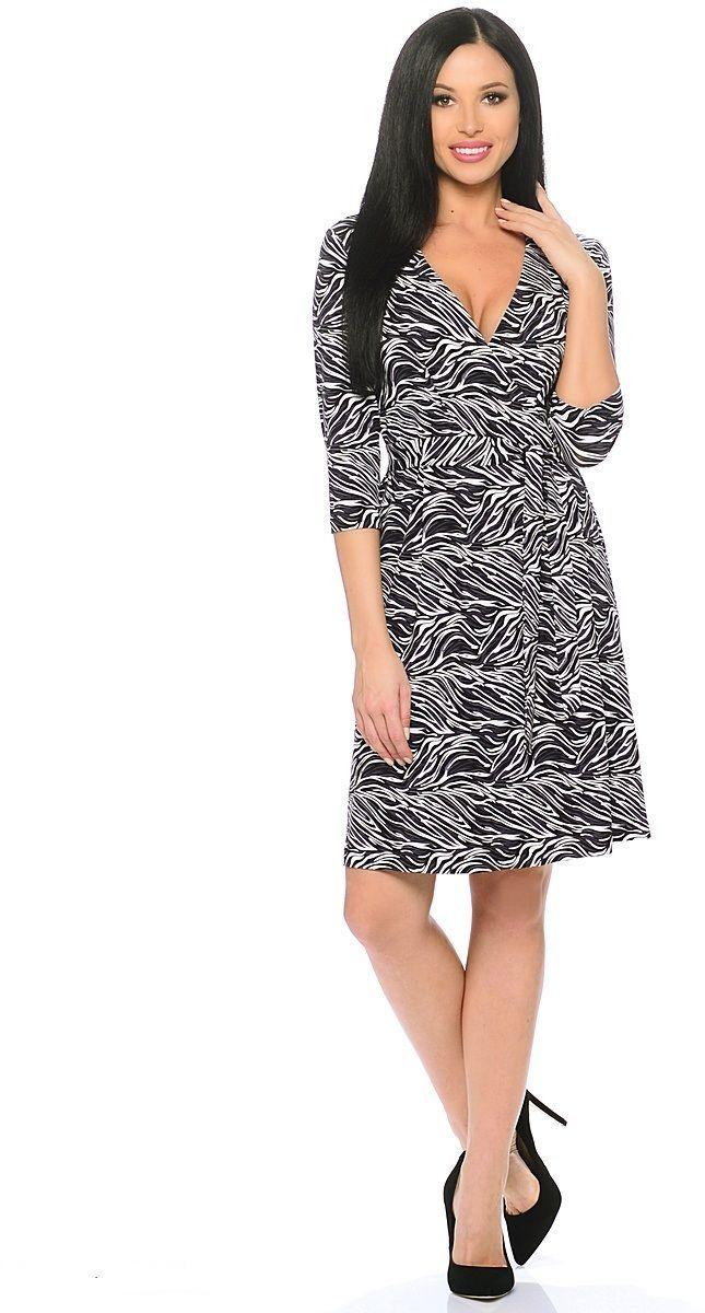 Платье Milton, цвет: черный, белый. WD-2611F. Размер 48WD-2611FТрикотажное платье полуприлегающего силуэта, отрезное по талии, с имитацией запаха, со съемным поясом. У талии по юбке и лифу - мягкие складки, рукава втачные длиной 1/2.