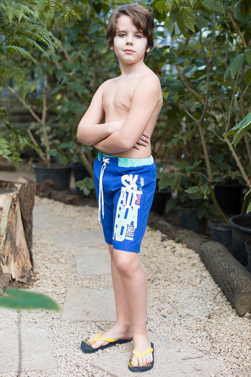 Шорты купальные для мальчика Luminoso, цвет: бирюзово-голубой. 717066. Размер 140717066Купальные шорты для мальчика выполнены из легкого быстросохнущего материала. Пояс-резинка дополнен шнуром для регулирования объема.