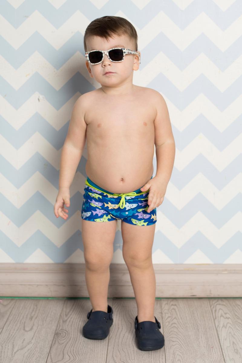 Плавки для мальчика Sweet Berry, цвет: голубой. 711055. Размер 122711055Плавки-боксеры для мальчика Sweet Berry Baby изготовлены из нейлона с добавлением эластана и оформлены оригинальным принтом с изображением акул. Плавки имеют пояс на мягкой эластичнойрезинке, дополнительно регулируемый шнурком, который не сдавливает живот ребенка и надежно фиксирует изделие на талии.Модель комфортна в носке, быстро сохнет и сохраняет первоначальный вид и форму при длительном использовании.