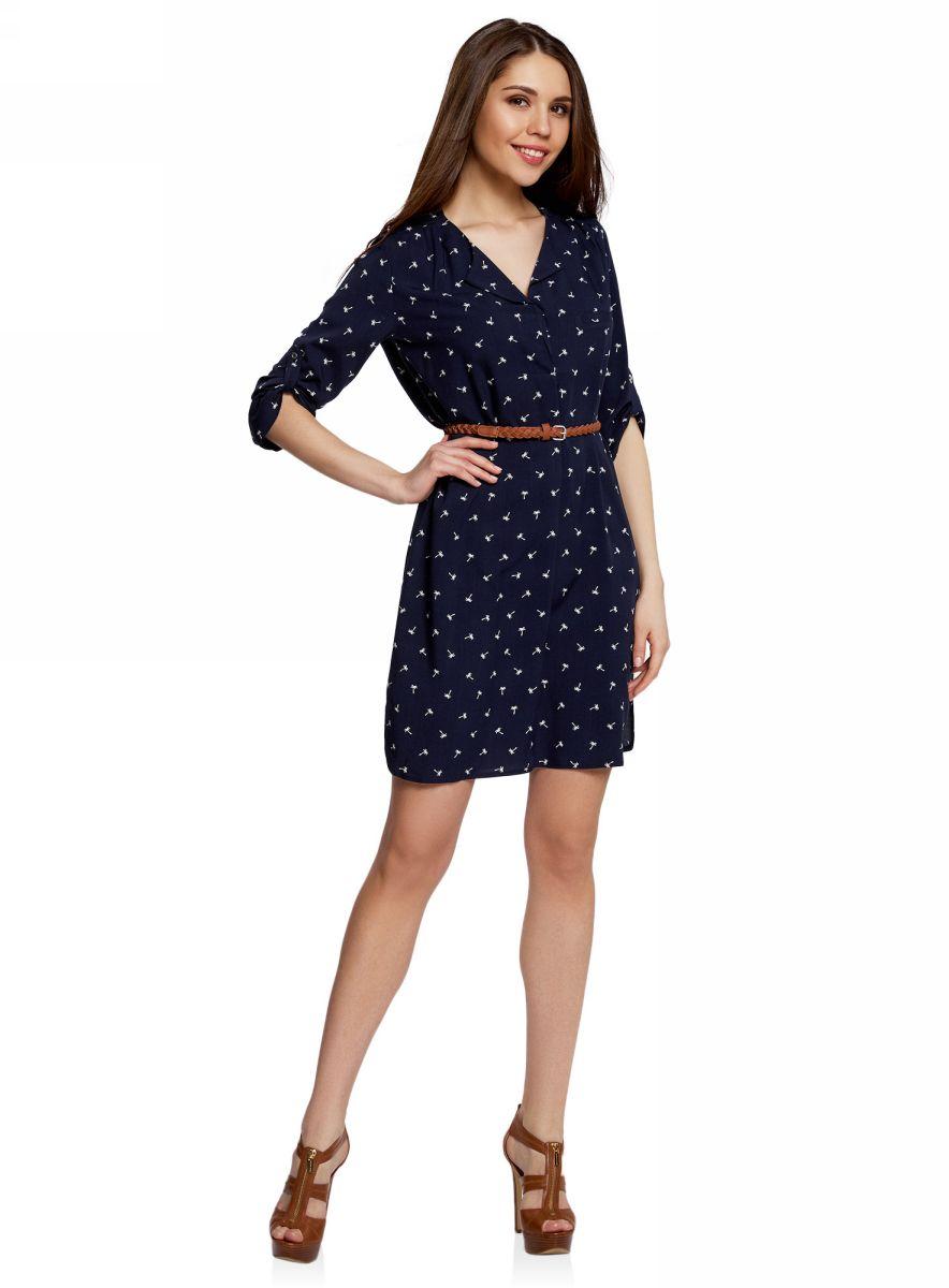 Платье oodji Ultra, цвет: темно-синий, белый. 11900180B/42540/7912Q. Размер 34-170 (40-170)11900180B/42540/7912QПлатье свободного силуэта oodji Ultra, выполненное из мягкой струящейся ткани, поможет создать модный образ. Модель средней длины с рукавами 3/4 и воротником с лацканами застегивается на пуговицы на груди, скрытые планкой, и дополнена небольшим прорезным карманом. Рукава можно подвернуть и зафиксировать хлястиком на пуговице. В комплект с платьемвходит узкий ремень из искусственной кожи с металлической пряжкой.