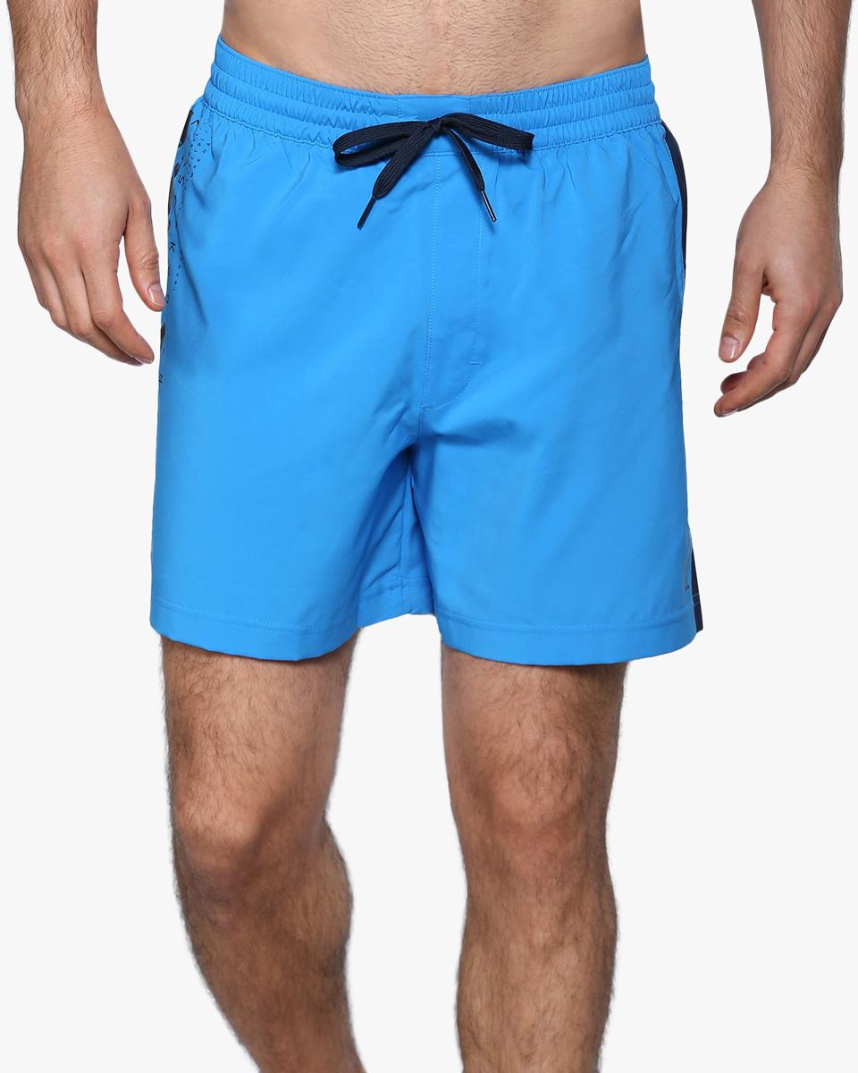 Шорты для плавания мужские Reebok Bw Volley Short, цвет: голубой. BK4818. Размер XS (42)BK4818Мужские шорты Reebok Bw Volley Short классического дизайна выполнены из высококачественного материала. Эти стильные шорты идеально подойдут любителям пляжного волейбола. Пояс на шнурке подчеркнет ваш спортивный настрой, а графические вставки по бокам сделают образ еще более интересным.Накладной карман для мелочей.Стильные графические элементы в дизайне.