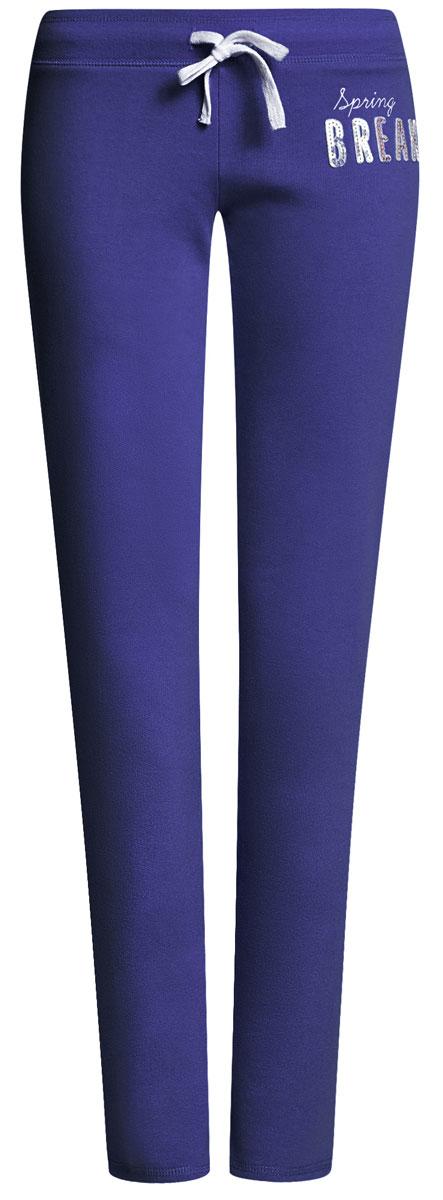 Брюки спортивные женские oodji Ultra, цвет: синий. 16700045-2B/46949/7500N. Размер S (44)16700045-2B/46949/7500NЖенские спортивные брюки oodji Ultra, выполненные из натурального хлопка, великолепно подойдут для отдыха и занятий спортом. Модель дополнена широкой эластичной резинкой на поясе. Объем талии регулируется с внешней стороны при помощи шнурка-кулиски.