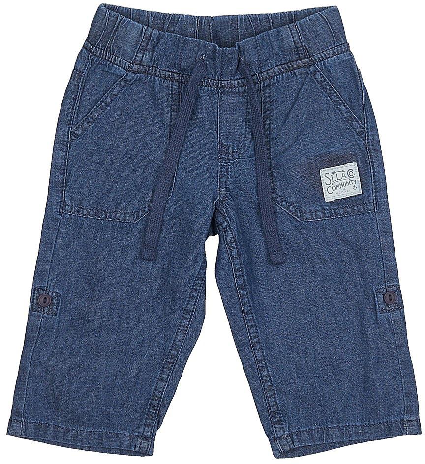 Бриджи для мальчика Sela, цвет: синий джинс. Psj-735/099-7213. Размер 98, 3 годаPsj-735/099-7213Стильные джинсовые бриджи для мальчика Sela выполнены из натурального хлопка. Бриджи свободного кроя и стандартной посадки на талии имеют широкий пояс на мягкой резинке, дополнительно регулируемый шнурком. Спереди модель дополнена двумя накладными карманами. Бриджи можно подвернуть и зафиксировать при помощи хлястиков на пуговицах.