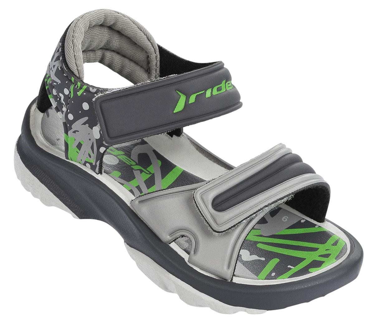 Сланцы детские Rider K2 Twist Vi Baby, цвет: темно-серый, светло-серый. 81912-20996. Размер 22 (23)81912-20996Стильные детские сандалии K2 Twist Vi Baby от Rider выполнены из ЭВА материала. Ремешки с застежками-липучками отвечают за надежную фиксацию модели на ножке вашего ребенка. Стелька из материала ЭВА для максимального комфорта и амортизации. Гибкая подошва дополнена рифлением.