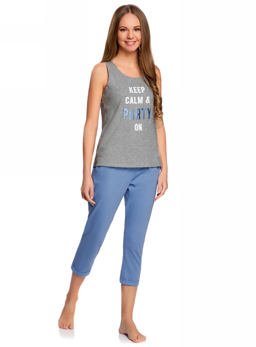 Пижама женская oodji Ultra, цвет: синий, серый. 56002206-2/46897/7523P. Размер S (44)56002206-2/46897/7523PЖенская пижама от oodji, состоящая из майки и бридж, выполнена из хлопкового материала. Майка спереди оформлена принтованной надписью, бриджи – однотонные.