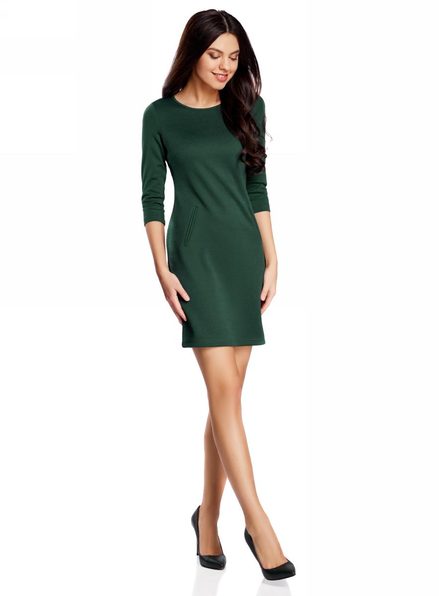 Платье oodji Collection, цвет: темно-изумрудный. 24001100-2/42408/6E00N. Размер XL (50)24001100-2/42408/6E00NПлатье от oodji облегающего силуэта выполнено из высококачественного трикотажа. Модель с рукавами 3/4 дополнена карманами.
