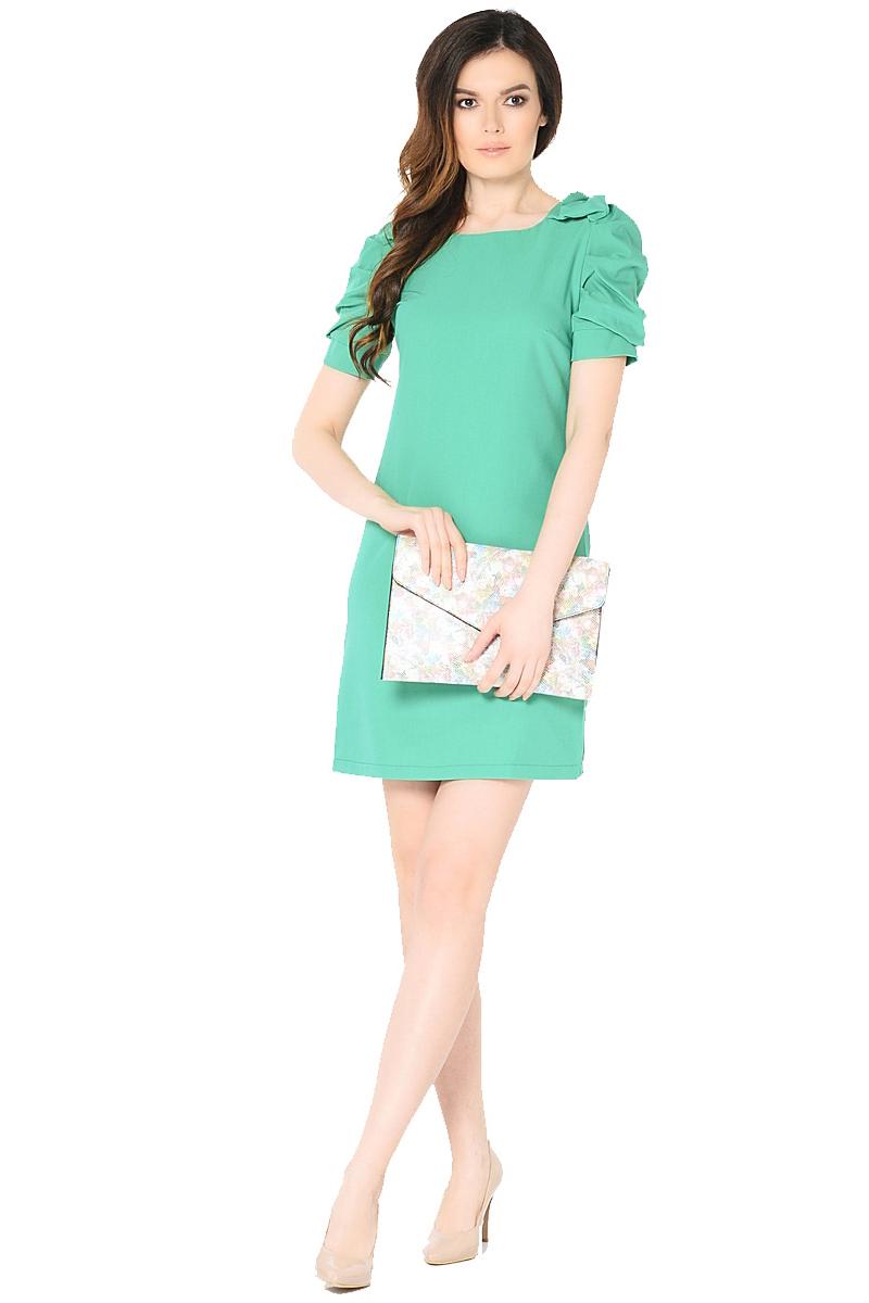 Платье Milton, цвет: зеленый. WD-2453F. Размер 42WD-2453FПлатье полуприлегающего силуэта, с втачными рукавами с драпировкой. На плечевых швах - отделочные банты из основной ткани.