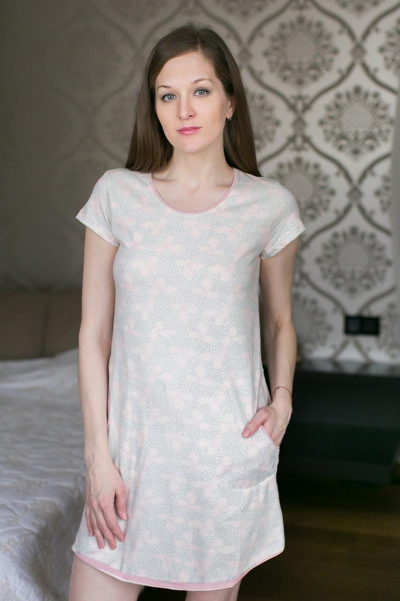 Платье домашнее Marusя, цвет: розовый. 160037. Размер L (48)160037Домашнее платье Marusя изготовлено из качественной смесовой ткани. Модель длины мини оформлена оригинальным рисунком. Платье с круглым вырезом горловины и короткими рукавами дополнено двумя карманами.