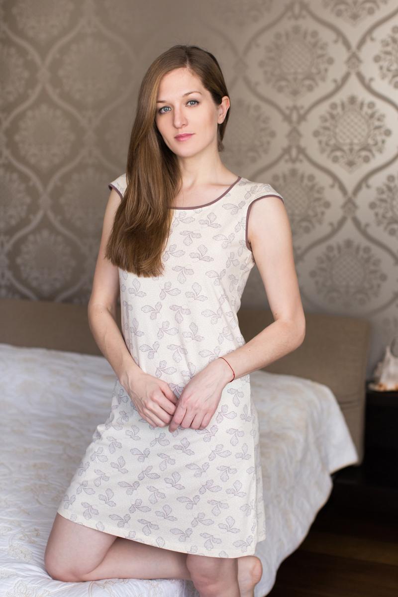 Платье домашнее Marusя, цвет: белый, шоколадный. 160070. Размер S (44)160070Домашнее платье Marusя изготовлено из качественной смесовой ткани. Модель длины мини оформлена оригинальным рисунком. Платье с круглым вырезом горловины и короткими рукавами.