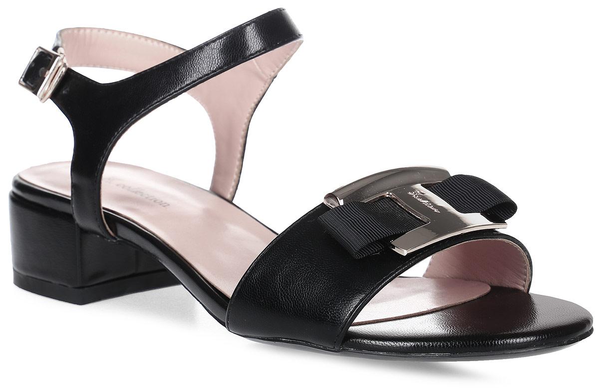 Босоножки женские LK collection, цвет: черный. SP-QA0401-1 PU (SP-Q03002-4). Размер 40SP-QA0401-1 PU (SP-Q03002-4)Стильные босоножки на низком каблуке выполнены из искусственной кожи. Стелька выполнена из натуральной кожи. Босоножки фиксируются на ноге при помощи застежки-пряжки.