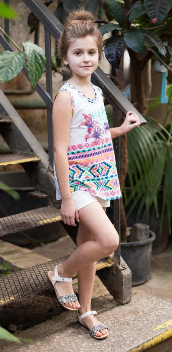Майка для девочки Luminoso, цвет: белый. 718005. Размер 146718005Трикотажная майка-топ для девочки из принтованной ткани декорирована яркой аппликацией.