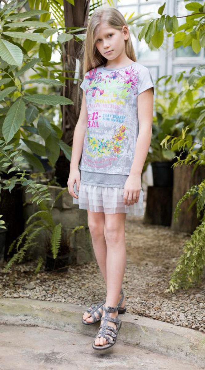 Платье для девочки Luminoso, цвет: белый. 718010. Размер 140718010Платья свободного кроя для девочки из трикотажной ткани с ярким принтом. Низ изделия декорирован воланом из тафты.