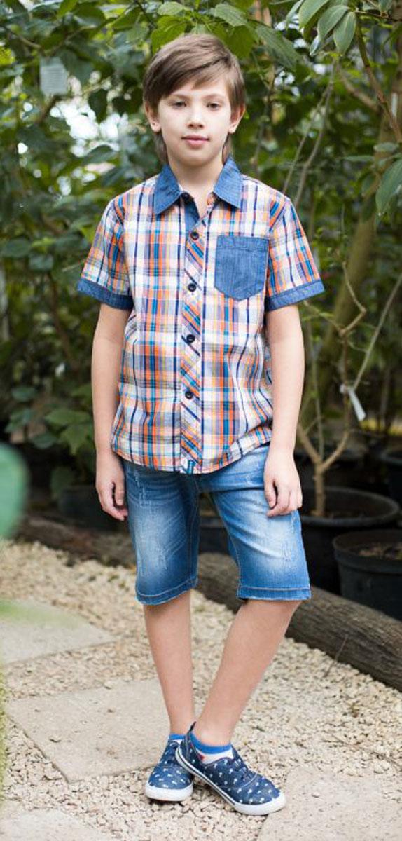 Рубашка для мальчика Luminoso, цвет: синий. 717046. Размер 164717046Текстильная рубашка из хлопка в клетку для мальчика. Короткий рукав, накладной карман на левой полочке. Застегивается на кнопки. Отложной воротничок.