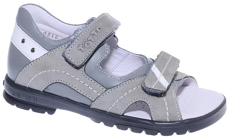 Сандалии для мальчика Тотто, цвет: серый, белый. 10215-КП. Размер 3010215-КПСтильные сандалии для мальчика от Тотто выполнены из натуральной высококачественной кожи и оформлены вставками из натурального нубука, конгревом в виде названия бренда на одном из ремешков, декоративной прострочкой, металлическими заклепками. Модель фиксируется на ножке ребенка при помощи двух ремешков с застежками-липучками. Закрытый жесткий задник защищает детскую стопу от повреждений при движении. Внутренняя поверхность и стелька изготовлены из натуральной кожи. Стелька дополнена супинатором, который отвечает за правильное положение ноги ребенка при ходьбе, предотвращает плоскостопие. Перфорация на стельке позволяет ножкам дышать. Ортопедический каблук Томаса (каблук высотой от 2 до 5 мм) укрепляет подошву под средней частью стопы и препятствует заваливанию детской стопы внутрь. Каблук и подошва, выполненные из ТЭП, дополнены рифленой поверхностью.