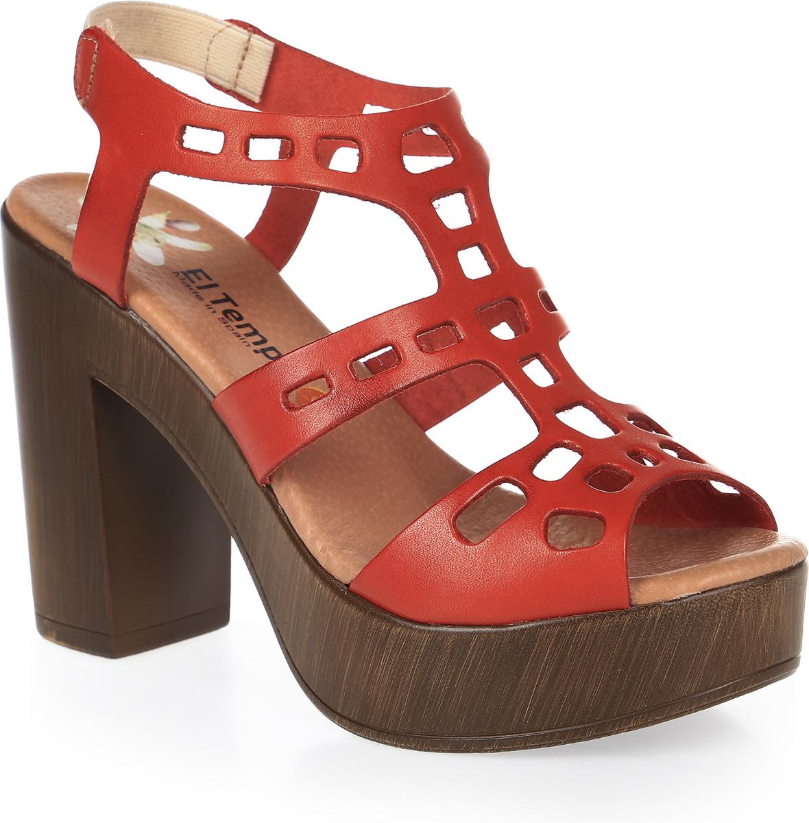 Босоножки женские El Tempo, цвет: темно-красный. ESA24_3507. Размер 40ESA24_3507_CORALСтильные босоножки от El Tempo выполнены из натуральной высококачественной кожи и оформлены оригинальной декоративной перфорацией. Резинка на заднике отвечает за идеальную посадку модели на ноге. Внутренняя поверхность и стелька изготовлены из натуральной кожи, которая обеспечивает комфорт при ходьбе. Высота каблука компенсирована платформой в носочной части. Подошва из полиуретана дополнена рельефной поверхностью.