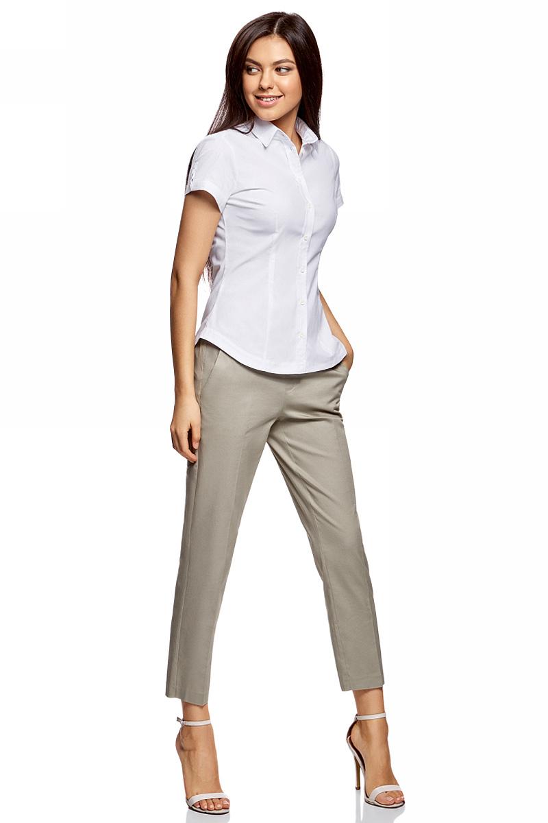 Рубашка женская oodji Ultra, цвет: белый. 11401238-2B/45151/1000N. Размер 36-170 (42-170)11401238-2B/45151/1000NРубашка женская oodji Ultra выполнена из высококачественного материала. Модель с отложным воротником и короткими рукавами застегивается на пуговицы.