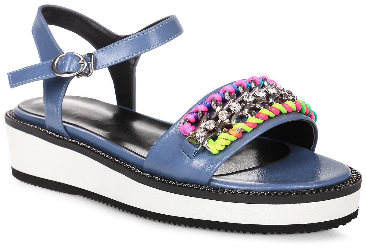 Сандалии женские LK Collection, цвет: синий. SP-QA1601-1 PU (SP-Q11001-2). Размер 38SP-QA1601-1 PU (SP-Q11001-2)Удобные сандалии на плоской подошве выполнены из искусственной кожи. Стелька выполнена из натуральной кожи. Сандалии фиксируются на ноге при помощи застежки-пряжки.