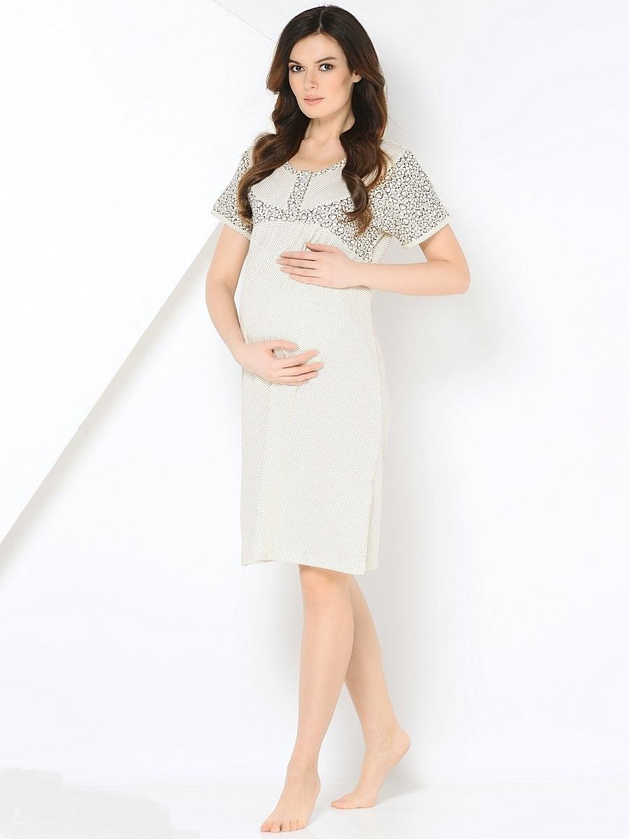 Сорочка ночная для беременных и кормящих 40 недель, цвет: молочный. 180127. Размер 46180127Комфортная хлопковая сорочка для беременных от бренда 40 недель покорит вас своим дизайном и функциональностью. Модель с коротким цельнокроеным рукавом, дополненная кокеткой на пуговицах. Мягкая, хлопковая ткань, женственный продуманный крой и окантовка делают сорочку комфортной и любимой. Приятная пастельная цветовая гамма создаст хорошое настроение. Сорочка подойдет как на всем сроке беременности, так и в период грудного кормления.