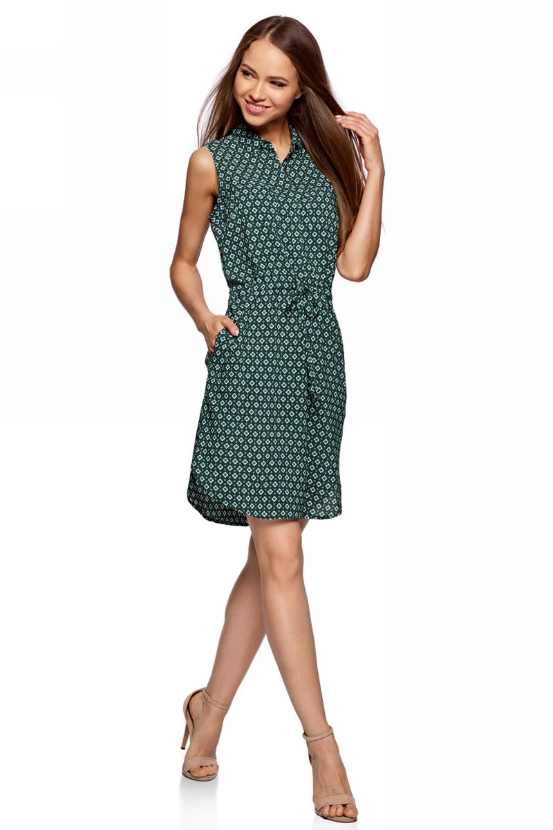 Платье oodji Ultra, цвет: темно-изумрудный, белый. 11901147-2/24681/6E12G. Размер 38-170 (44-170)11901147-2/24681/6E12GСтильное платье oodji изготовлено из качественного материала. Модель выполнена без рукавов и застегивается сверху на пуговицы около отложного воротничка. На талии имеется утяжка.