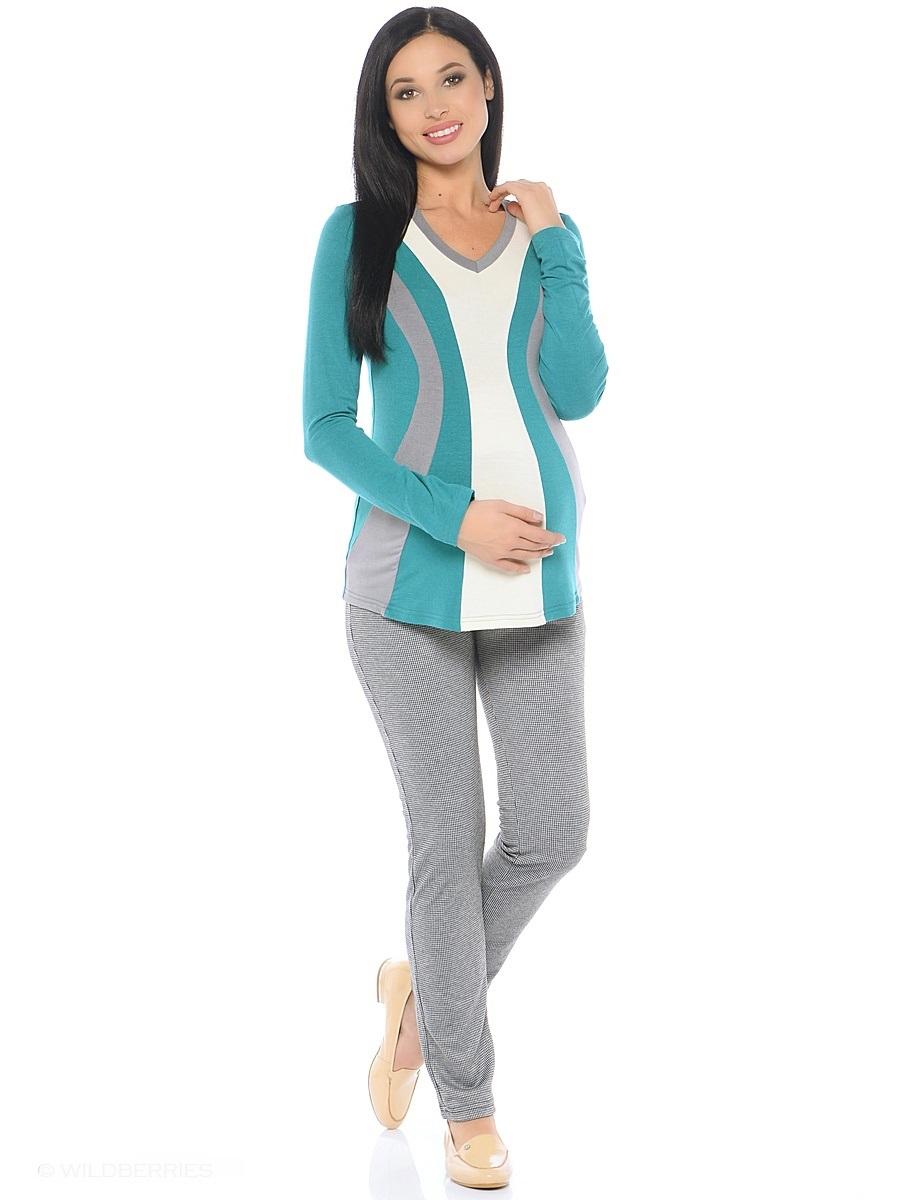 Блузка для беременных 40 недель, цвет: бирюзовый, серый, молочный. 200229. Размер 46200229Модная блузка для беременных от бренда 40 недель выполнена из вискозного полотна в комбинированной расцветке. Модель полуприталенного силуэта, с длинным рукавом и V-образным вырезом горловины. Передняя часть блузки выполнена из фигурных клиньев в гармоничной цветовой гамме. Такой крой визуально делает силуэт стройнее, создает объем для животика и позволяет комбинировать такую блузку со многими предметами гардероба на протяжении всего срока беременности и после него.