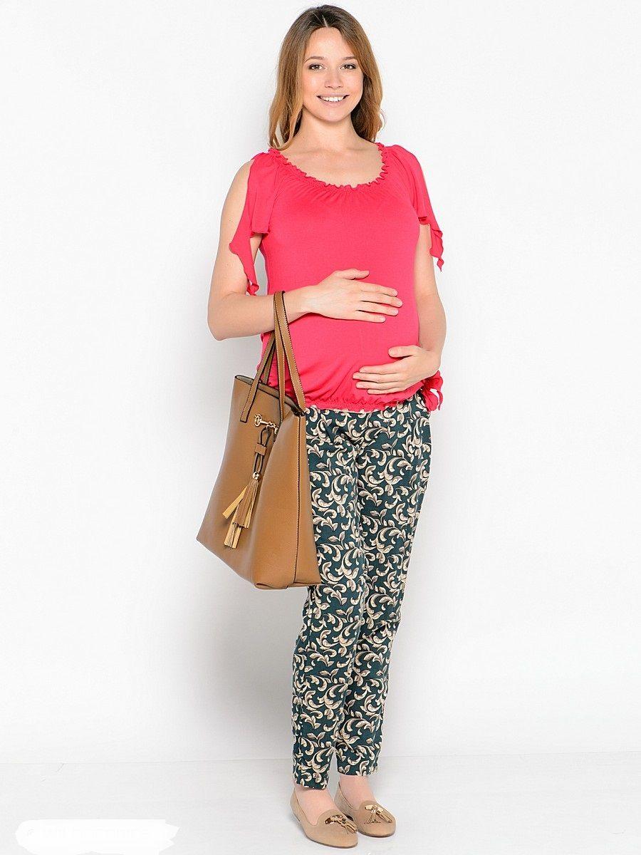 Футболка для беременных 40 недель, цвет: коралловый. 24265. Размер 4824265Яркая, стильная футболка для беременных от бренда 40 недель выполнена из мягкого эластичного трикотажа. Края изделия присобранны на мягкие резиночки, образующие красивые рюшечки и объем для животика в период беременности. После рождения малыша такой фасон скроет временные несовершенства фигуры. Оригинальные завязки на коротких рукавах и по бокам внизу, украшают придают изюминку. Футболка, комбинируется с любым низом, подчеркивает женственность образа, обеспечивая комфорт.
