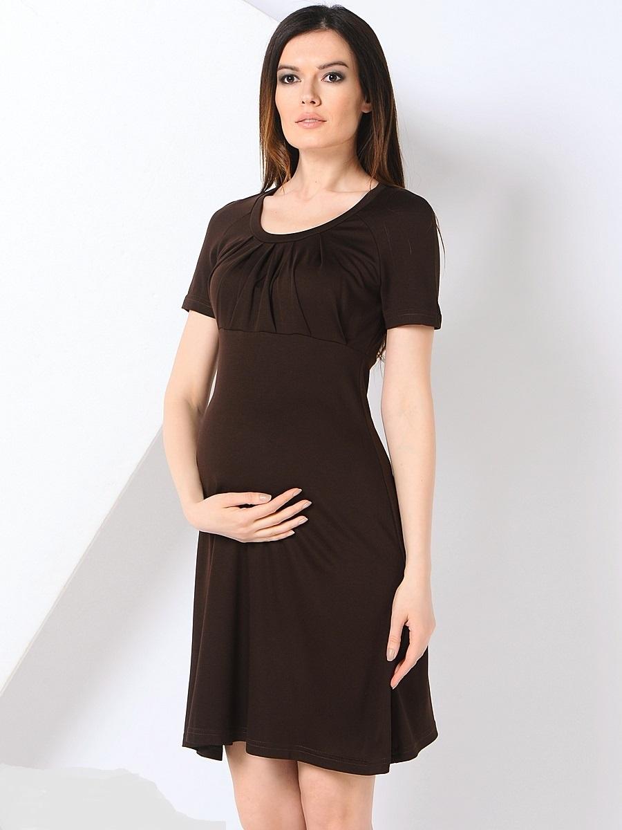 Платье для беременных 40 недель, цвет: темно-коричневый. 301355. Размер 44301355Платье для беременных от бренда 40 недель - прекрасный вариант на каждый день. Изделие выполнено из хлопка с добавлением лайкры. Модель с коротким рукавом-реглан и круглым вырезом горловины. Оригинально задрапированный лиф и трапециевидный покрой создают элегантный образ уверенной в себе женщины. Благодаря уникальному крою это платье вы сможете носить на протяжении всего срока беременности и после него. Такое платье идеальный вариант для различных мероприятий и для работы в офисе.