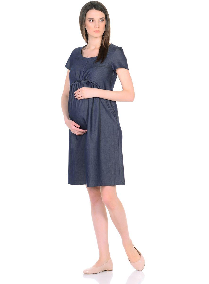 Платье для беременных 40 недель, цвет: темно-синий. 300317. Размер 44300317Стильное платье для беременных от бренда 40 недель выполнено из легкого денима. Модель свободного покроя, со встречными складками от фигурной кокетки, имеет короткие рукава и округлый вырез горловины. Современный фасон с точностью продуман под особенности фигуры беременной женщины, благодаря этому платье не сковывает движений, создает комфорт в процессе носки.Лаконичный фасон в нейтральной расцветке позволяет дополнять такое платье любыми предметами гардероба, украшениями и аксессуарами, создавая различные образы на каждый день или для особых случаев.