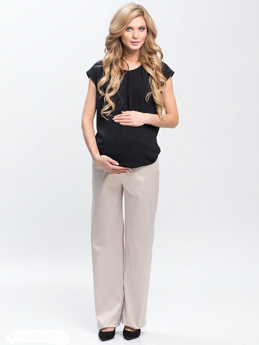 Брюки для беременных 40 недель, цвет: бежевый. 146. Размер 54146Брюки для беременных от бренда 40 недель - прекрасный выбор на каждый день для будущей мамы. Модель выполнена из текстильного полотна. Брюки прямые, под животик, с трикотажной кокеткой по поясу. Комфортная модель классического покроя подойдет как для работы в офисе, так и на каждый день.