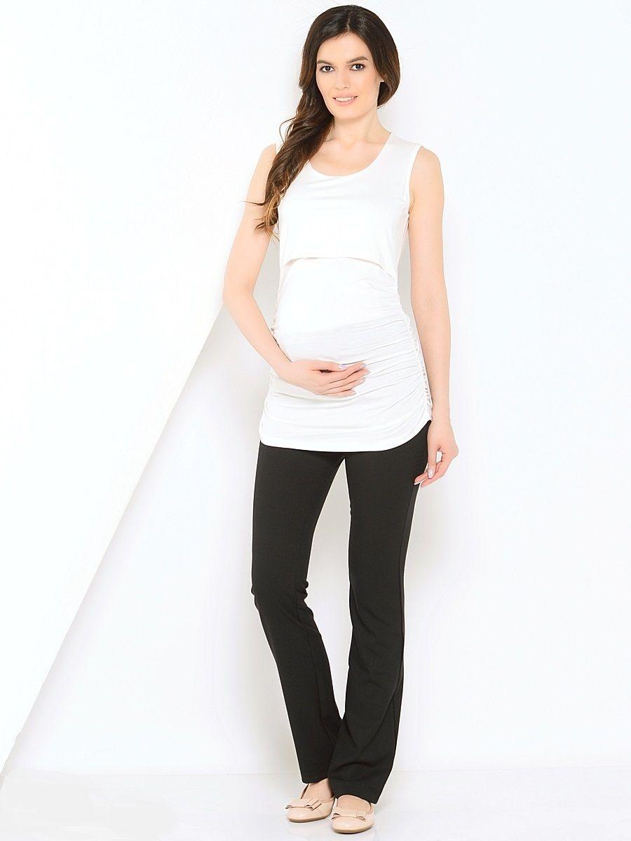 Брюки для беременных 40 недель, цвет: черный. 10107/9. Размер 5210107/9Модные брюки для беременных от бренда 40 недель, выполненные из мягкого трикотажного полотна, подарят комфорт будущей маме.Модель прямого покроя, дополнена шлевками для ремня и мягким поясом. Брюки отлично садятся по фигуре, не сковывают движений, обеспечивают комфорт на любом сроке беременности.Брюки прекрасно комбинируются со многими предметами гардероба классического офисного и повседневного стилей.