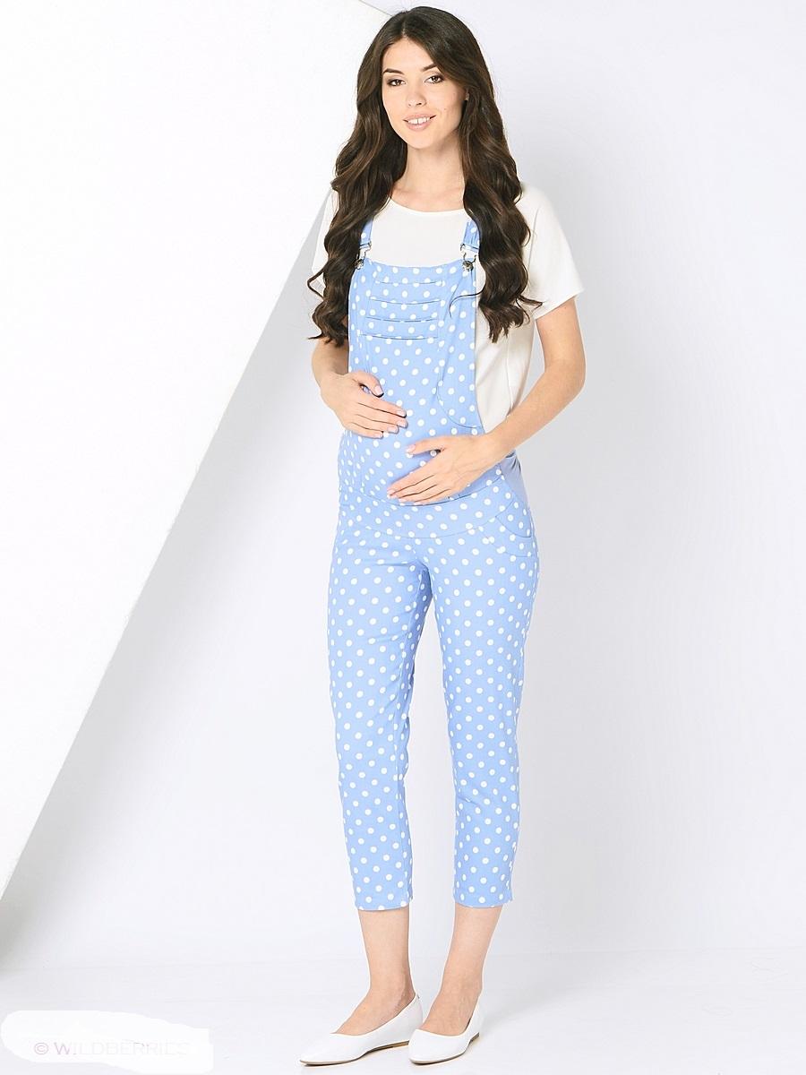 Комбинезон для беременных 40 недель, цвет: голубой. 101198. Размер 48101198Модный комбинезон для беременных от бренда 40 недель - идеальный выбор для будущей мамы! Модель с укороченными брючками длиной 7/8 выполнена из мягкого эластичного материала и дополнена двумя задними карманами. Современная модель с хорошей поддержкой для растущего животика, обхват регулируется с помощью эластичных вставок по бокам и резинок, бретели регулируются по длине. Комбинезон хорошо садится по фигуре, мягко поддерживает животик, сохраняя свободу и легкость движений на любом сроке беременности.