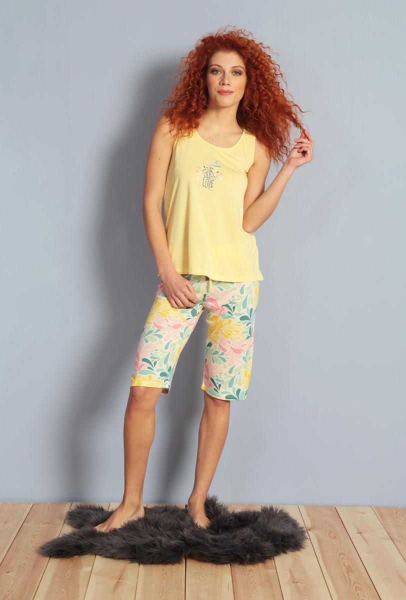 Домашний комплект женский Kezokino, цвет: желтый. 609085 1167. Размер XL (50)609085 1167Красивый комплект, выполненный из 100% вискозы, состоит из майки и шорт средней длины приятной расцветки. Отличный вариант для дома и отдыха на каждый день.