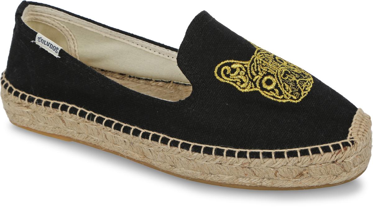 Слиперы женские Soludos Frenchie Embroidered Platform Slipper, цвет: черный, желтый. 1000157. Размер 7 (37)1000157-BLACKУдобные женские слиперы Frenchie Embroidered Platform Slipper от Soludos изготовлены из текстиля и оформлены вырезами в области подъема, фирменной нашивкой с названием бренда на боковой стороне, задним наружным ремнем, крупными декоративными стежками вдоль ранта. Мыс изделия декорирован оригинальной вышивкой в виде мордочки собаки. Внутренняя поверхность и стелька выполнены из текстиля, отвечающего за комфорт при движении. Верхняя часть подошвы изготовлена из плетеной джутовой нити, нижняя часть - из резины. Подошва дополнена рифленой поверхностью.