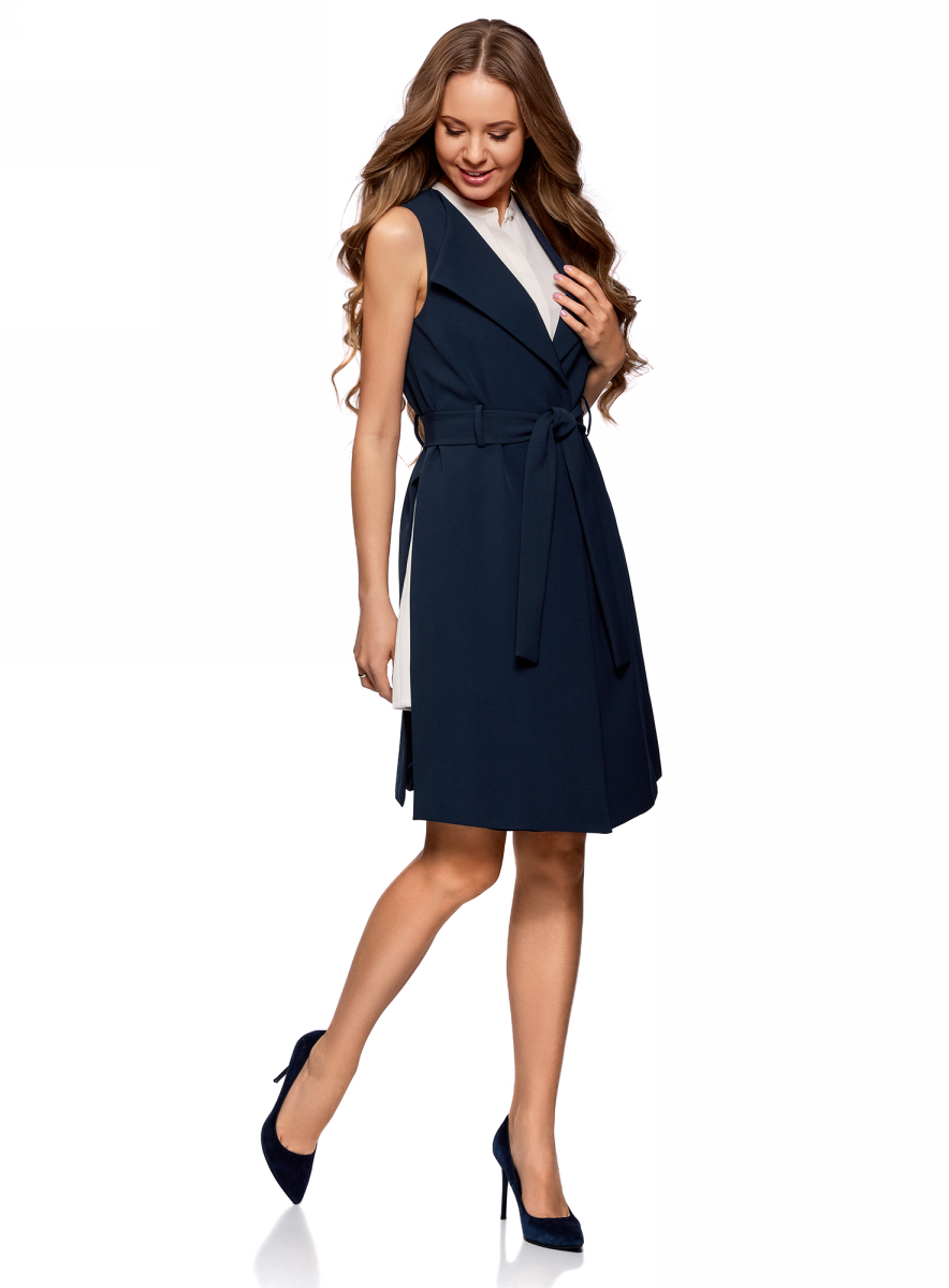 Жилет женский oodji Ultra, цвет: темно-синий. 12305006/45559/7900N. Размер 40-170 (46-170)12305006/45559/7900NУдлиненный женский жилет, выполненный из качественного материала на подкладке, отлично дополнит ваш образ. Модель без рукавов дополнена поясом.