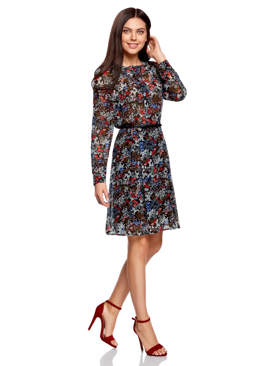 Платье oodji Collection, цвет: черный, красный, цветы. 21912001-1M/38375/2945F. Размер 40-164 (46-164)21912001-1M/38375/2945FПлатье oodji Collection полуприлегающего кроя выполнено из шифона и оформлено ярким принтом. Модель средней длины с круглым вырезом горловины и длинными рукавами-реглан застегивается спереди и на манжетах на пуговицы; сбоку имеется скрытая застежка-молния. Платье подойдет для офиса, прогулок и дружеских встреч и станет отличным дополнением гардероба в летний период. Мягкая ткань на основе полиэстера приятна на ощупь и комфортна в носке.В комплект с платьемвходит узкий ремень из искусственной кожи с металлической пряжкой.