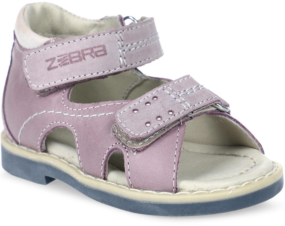 Сандалии для девочки Зебра, цвет: розовый. 10588-9. Размер 2010588-9Сандалии от Зебра выполнены из натуральной кожи. Внутренняя поверхность и стелька из натуральной кожи комфортны при ходьбе. Стелька дополнена супинатором, который обеспечивает правильное положение ноги ребенка при ходьбе и предотвращает плоскостопие. Ремешок с застежкой-липучкой позволяет прочно зафиксировать ножку ребенка. Ортопедический каблук Томаса укрепляет подошву под средней частью стопы и препятствует ее заваливанию внутрь.