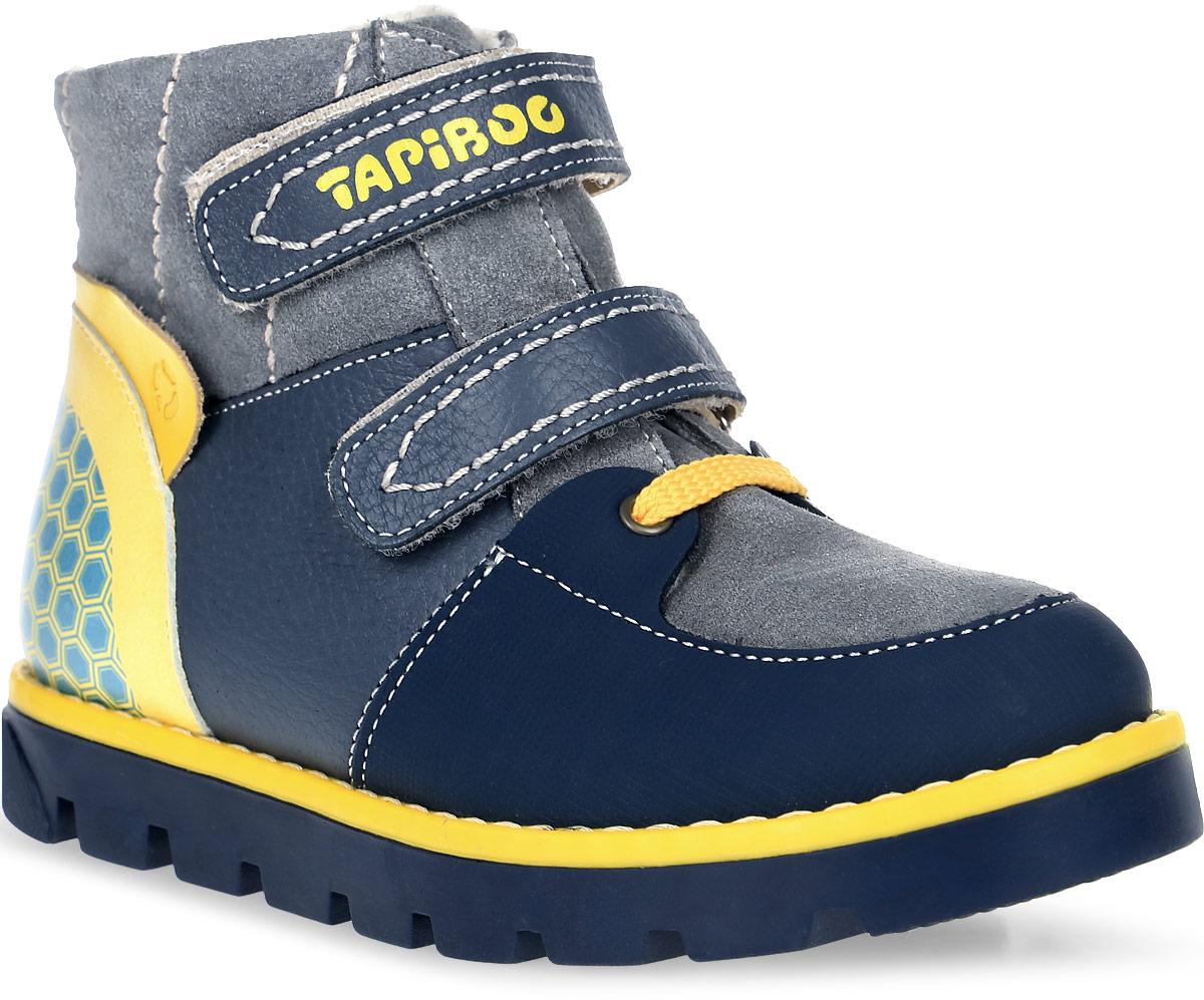 Ботинки детские TapiBoo, цвет: серый, желтый. FT-23003.16-OL12O.03. Размер 32FT-23003.16-OL12O.03Утепленные ботинки от TapiBoo придутся по душе как аленьким непосдам, так и их родителям. Многослойная, анатомическая стелька гарантирует правильное формирование стопы. Жесткий фиксирующий задник с удлиненным крылом надежно стабилизирует голеностопный сустав во время ходьбы. Упругая, умеренно-эластичная подошва, имеющая перекат позволяющий повторить естественное движение стопы при ходьбе для правильного распределения нагрузки на опорно-двигательный аппарат ребенка. Подкладка из байки Lanatex поддерживает комфортную температуру внутри обуви при погодных условиях от +5°С до -5°С градусов. Застежки типа велкро позволяют оптимально подогнать полноту обуви по ноге ребенка (большой подъем или вложение специальных вкладных ортопедических приспособлений), обеспечивая при этом оптимальную фиксацию стопы.