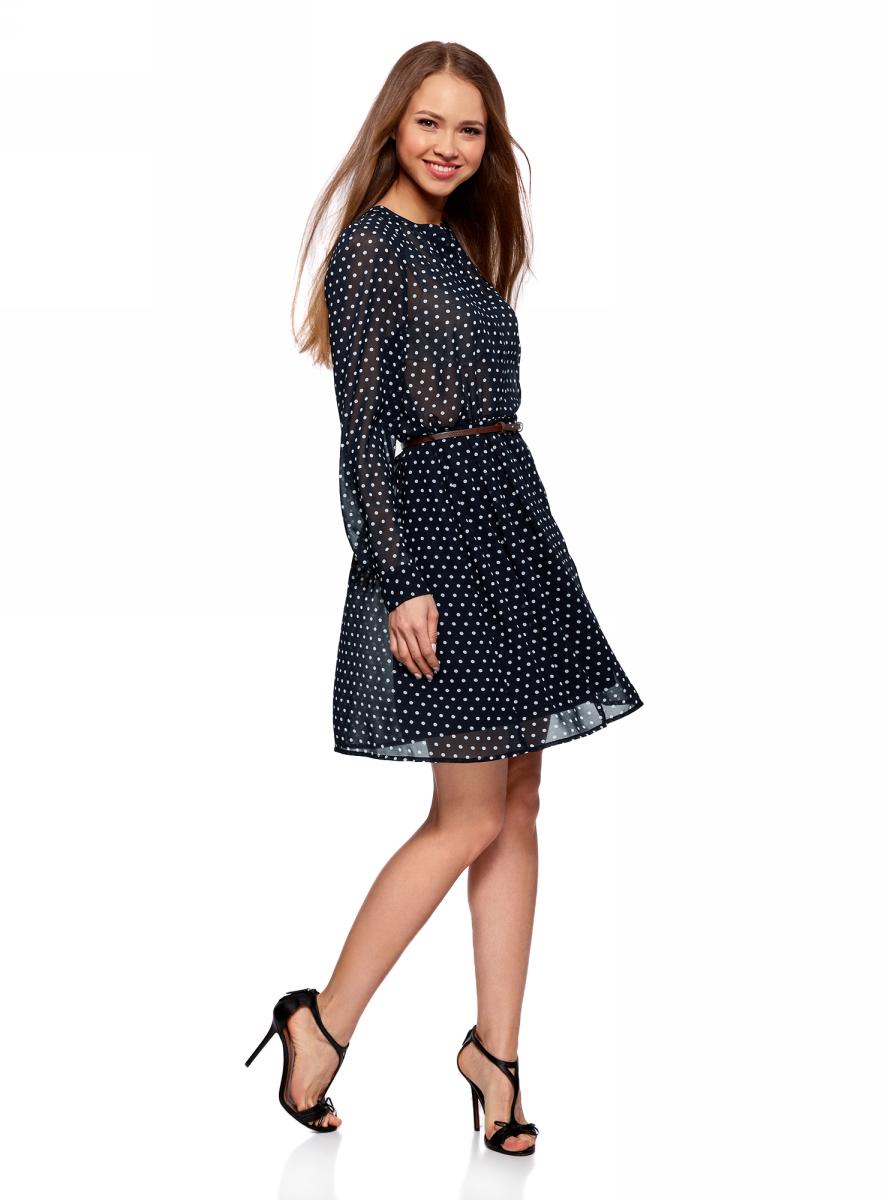 Платье oodji Collection, цвет: темно-синий, белый, горох. 21912001-1B/38375/7910D. Размер 36-170 (42-170)21912001-1B/38375/7910DПлатье oodji Collection полуприлегающего кроя выполнено из шифона и оформлено принтом в горох. Модель средней длины с круглым вырезом горловины и длинными рукавами-реглан застегивается спереди и на манжетах на пуговицы; сбоку имеется скрытая застежка-молния. Платье подойдет для офиса, прогулок и дружеских встреч и станет отличным дополнением гардероба в летний период. Мягкая ткань на основе полиэстера приятна на ощупь и комфортна в носке.В комплект с платьемвходит узкий ремень из искусственной кожи с металлической пряжкой.