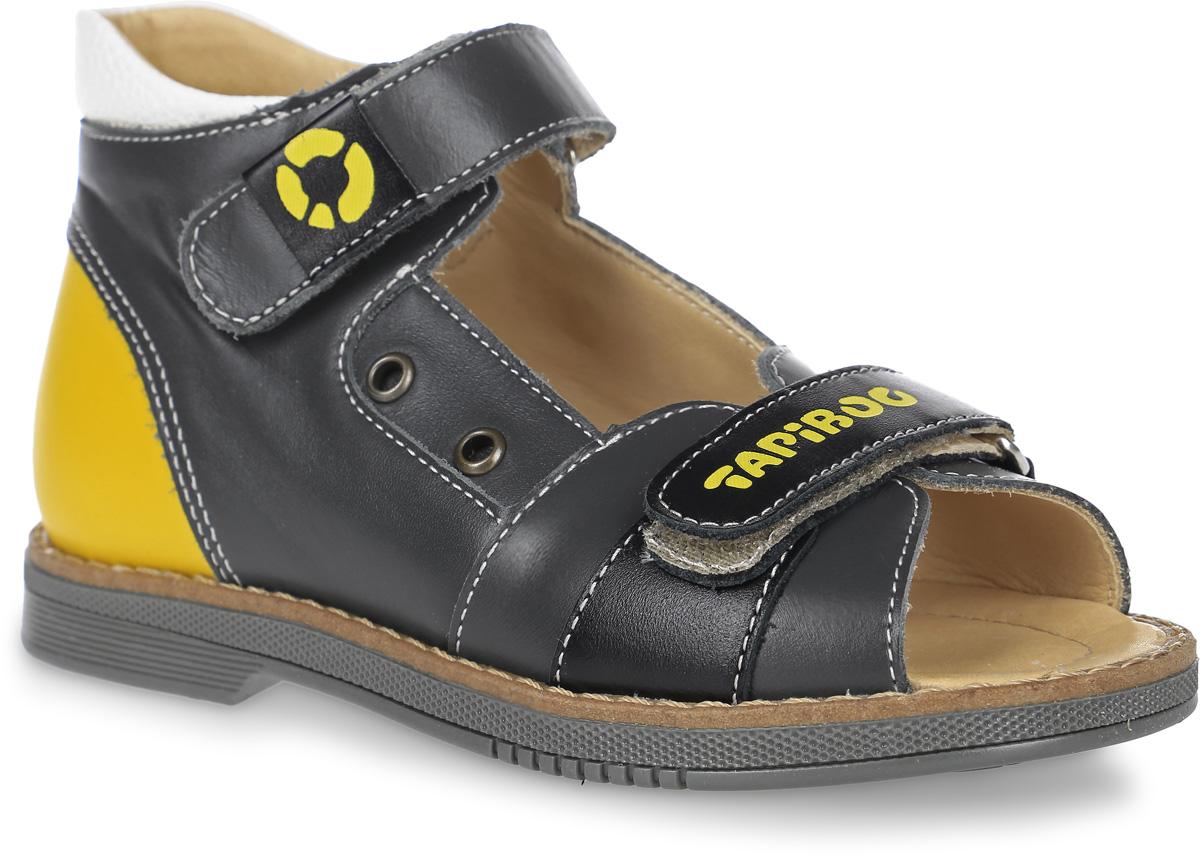 Сандалии для мальчика TapiBoo, цвет: черный, желтый. FFT-26003.17-OL12O.01. Размер 30FT-26003.17-OL12O.01Стильные сандалии от TapiBoo придутся по душе вашему мальчику. Модель, выполненная из натуральной кожи, оформлена прострочкой вдоль ранта и логотипом бренда на нижнем ремешке. Внутренняя поверхность из натуральной кожи гарантирует комфорт при движении. Анатомическая стелька из натуральной кожи с супинатором обеспечивает правильное формирование стопы. Жесткий фиксирующий задник с удлиненным «крылом», надежно стабилизирует голеностопный сустав во время ходьбы. Застегивается модель на два ремешка с липучками. Упругая подошва, имеющая перекат, позволяет повторять естественное движение стопы при ходьбе для правильного распределения нагрузки на опорно-двигательный аппарат ребенка. Ортопедический каблук Томаса укрепляет подошву под средней частью стопы и препятствует ее заваливанию внутрь. Рельефный рисунок подошвы обеспечивает сцепление с любыми поверхностями. Такие сандалии станут незаменимыми в гардеробе вашего ребенка.