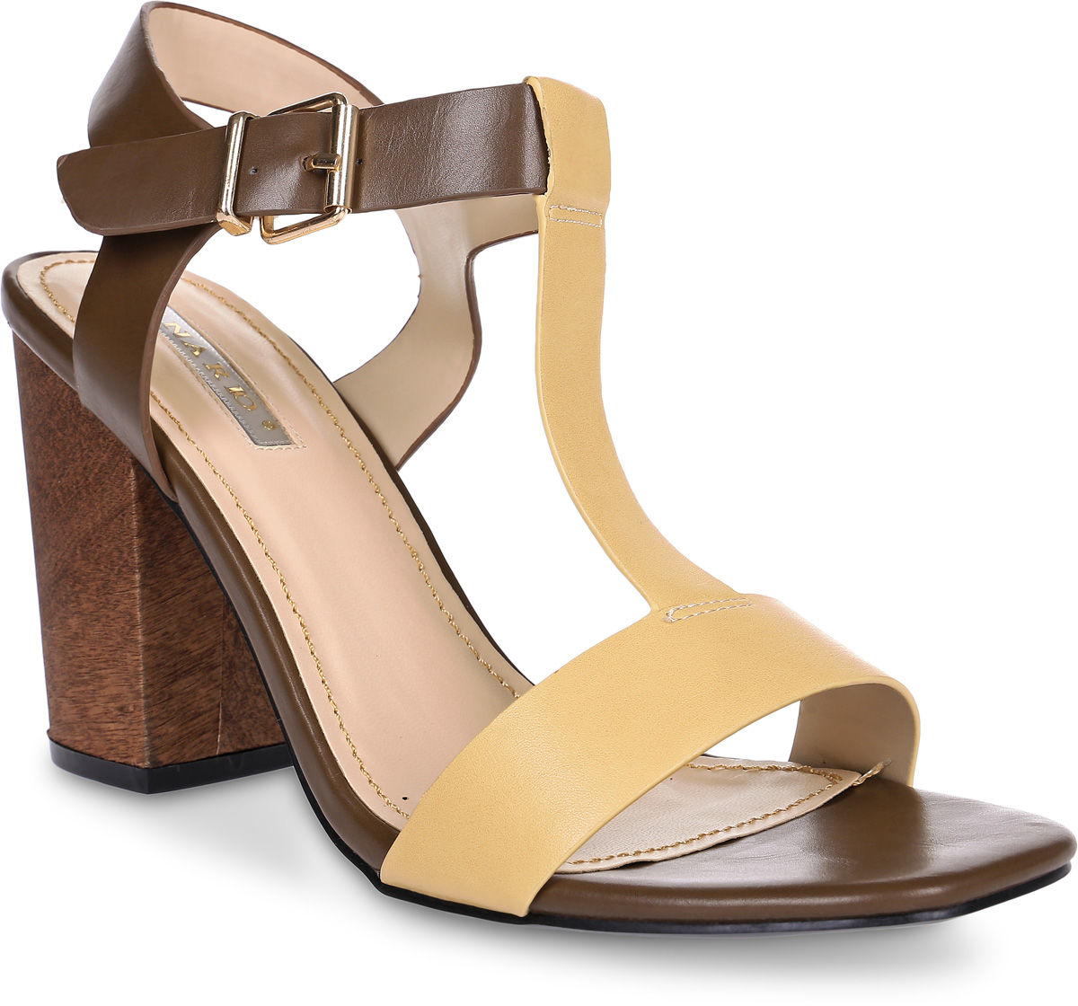 Босоножки Inario, цвет: коричневый, бежевый. 17044-02-18. Размер 3517044-02-18Босоножки Inario выполнены из искусственной кожи. Модель фиксируется на ноге при помощи ремешка на пряжке. Внутренняя поверхность и стелька из искусственной кожи создают комфорт при движении. Подошва выполнена из прочного полимерного материала. Модель имеет устойчивый каблук-столбик с декором под дерево.