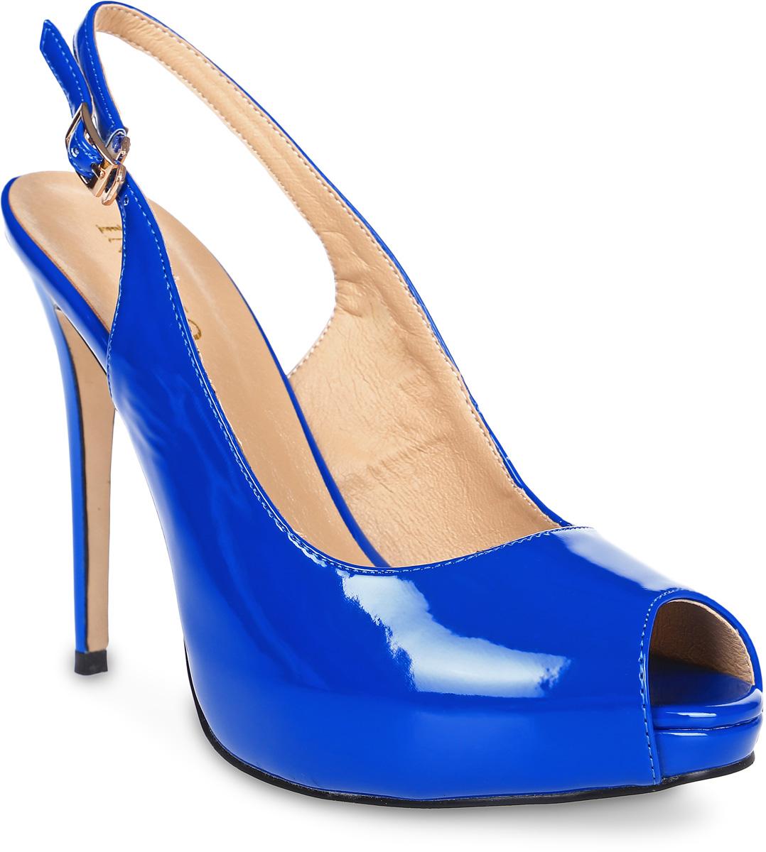 Туфли женские Inario, цвет: синий. 17164-01-8. Размер 3617164-01-8Элегантные туфли Inario с открытой пяткой и мыском выполнены из искусственной лаковой кожи. Внутренняя поверхность и стелька из искусственной кожи обеспечат комфорт при движении. Ремешок с металлической пряжкой надежно зафиксирует модель на вашей щиколотке. Модель имеет высокий каблук-шпильку.