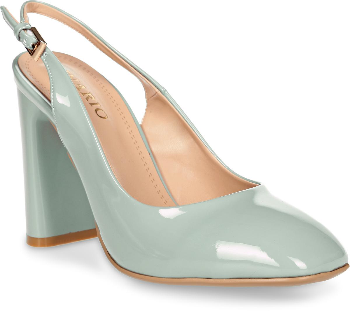 Туфли женские Inario, цвет: светло-зеленый. 17345-01-24. Размер 4017345-01-24Элегантные туфли Inario с открытой пяткой выполнены из искусственной лаковой кожи. Внутренняя поверхность и стелька из искусственной кожи обеспечат комфорт при движении. Ремешок с металлической пряжкой надежно зафиксирует модель на ноге. Туфли имеют круглый мысок и широкий устойчивый каблук.