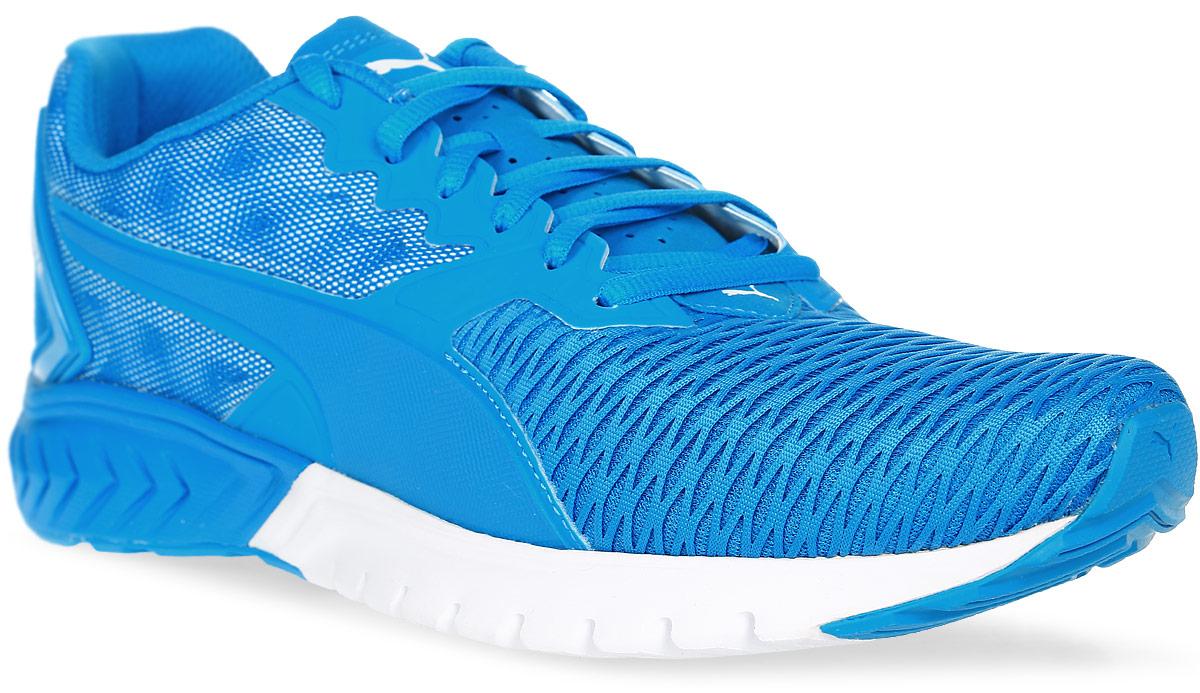 Кроссовки мужские для бега Puma Ignite Dual, цвет: голубой. 18909409. Размер 9 (42)18909409Низкопрофильная промежуточная подошва с зигзагообразным рисунком ранта в виде шеврона и специальные бороздки в области носка, повышающие эластичность, обеспечивают непревзойденную упругость, возврат энергии и максимальный комфорт, характерные для модели Ignite Dual. Носок отделан дышащим сетчатым материалам, а задник снабжен светоотражающими элементами, меняющими интенсивность цвета при движении ноги. Все эти детали придают модели актуальный и оригинальный облик.
