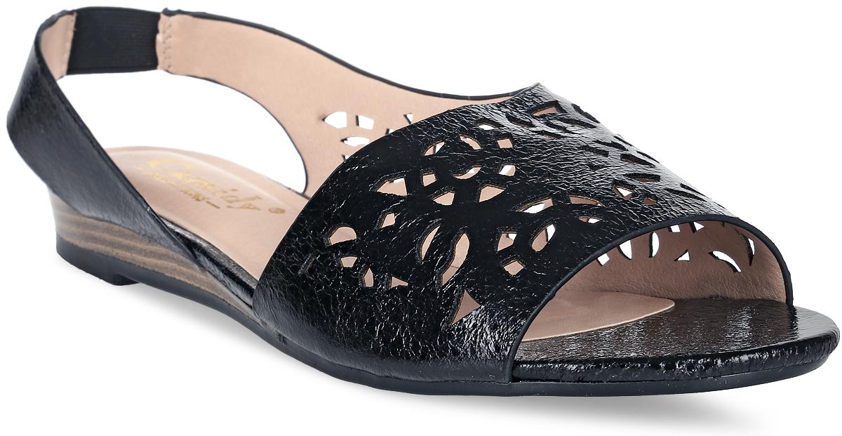 Сандалии женские Camidy, цвет: черный металлик. 735-11. Размер 40735-11Женские сандалии от Camidy выполнены из искусственной кожи и оформлены перфорацией. Подкладка и стелька, изготовленные из искусственной кожи, гарантируют комфорт и удобство стопам. Подошва из резины обеспечивает хорошую амортизацию и сцепление с любой поверхностью.