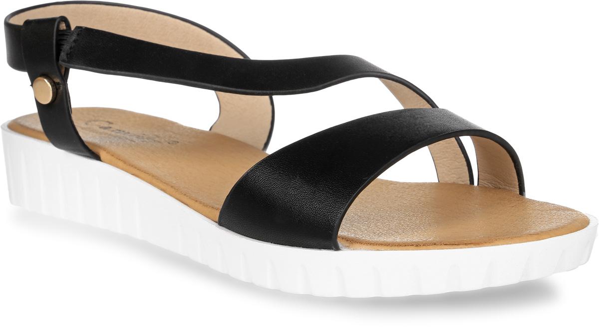 Сандалии женские Camidy, цвет: черный. 288-51. Размер 37288-51Женские туфли от Camidy выполнены из искусственной кожи. Модель фиксируется на ноге при помощи ремешка на пряжке. Подкладка и стелька из искусственной кожи гарантируют комфорт и удобство стопам. Подошва из резины обеспечивает хорошую амортизацию и сцепление с любой поверхностью.